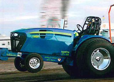 Blue tractor with front wheels in the air