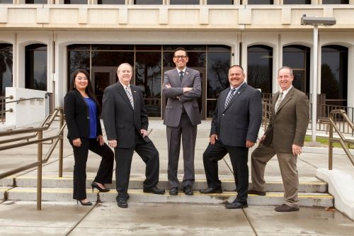 Board Members standing on building steps