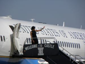 Michelle Obama exiting plane waving