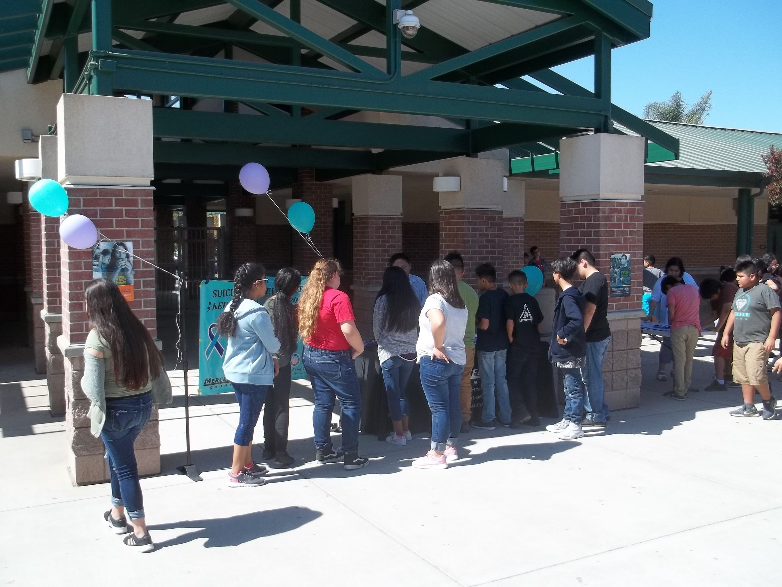 Picture of students at the Suicide Prevention resource table at Livingston Middle School Event on 09-10-18
