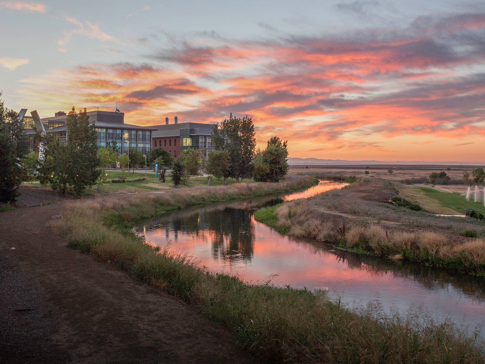 This image shows the sunrise over a canal at UC Merced