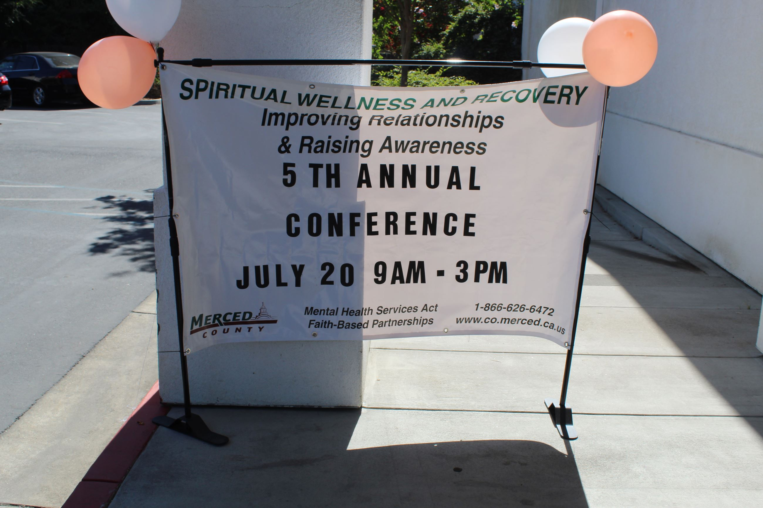 Picture of Outside Banner at the 2019 Spiritual Wellness and Recovery Conference